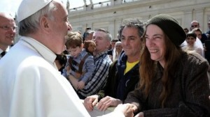 This-picture-released-by-the-Vatican-press-office-on-April-10-2013-shows-Pope-Francis-L-greeting-US-singer-Patti-Smith-during-the-pontifs-weekly-general-audience-at-St-Peters-square-at-the-Vatican.-AFP